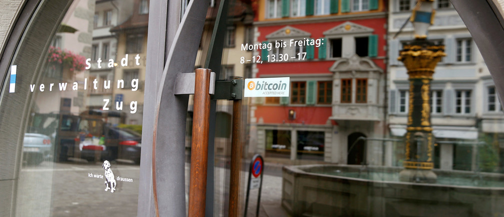"A sticker reading ""Bitcoin accepted here"" is displaye at the entrance of the Stadthaus town hall in Zug, Switzerland, August 30, 2016. Picture taken August 30, 2016.  REUTERS/Arnd Wiegmann  - RTX2OLUE"